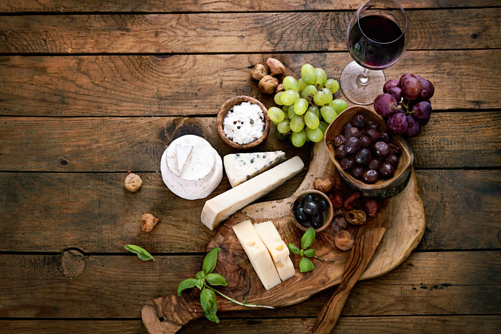 Wine, cheese, and grapes