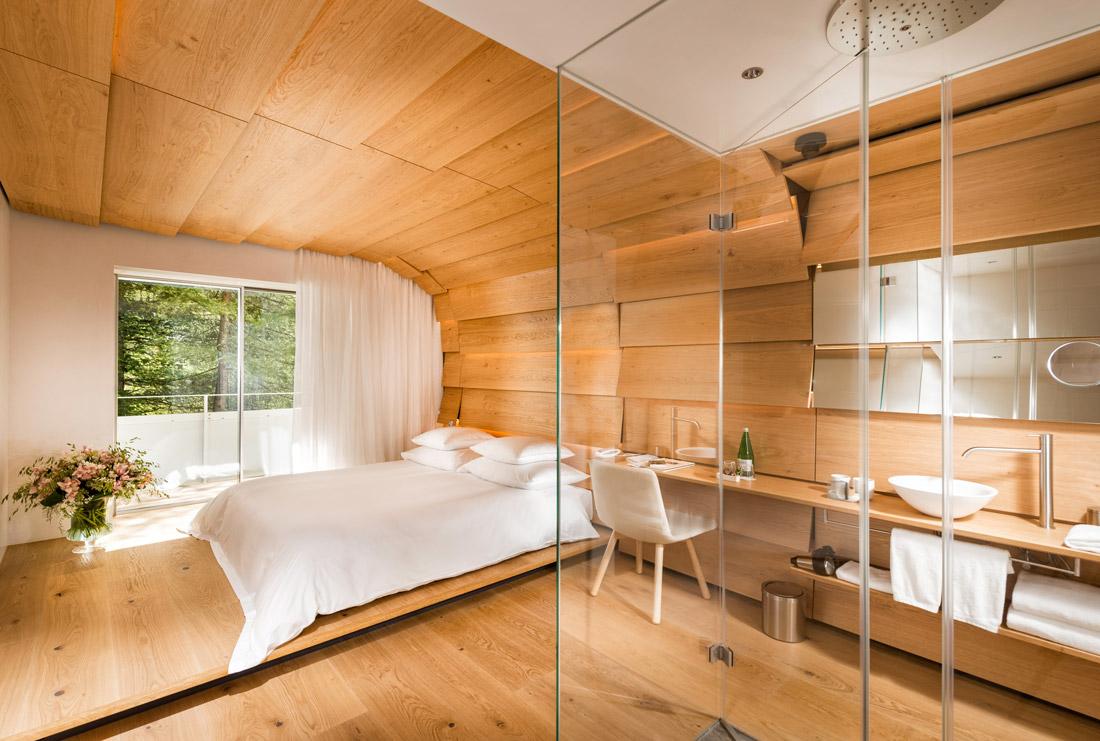 Bedroom decked out in blonde Swiss oak panels