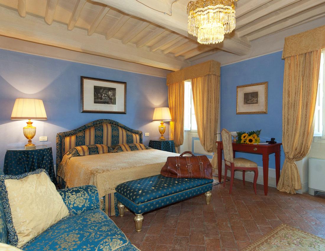 Palatial bedroom with terracotta floors
