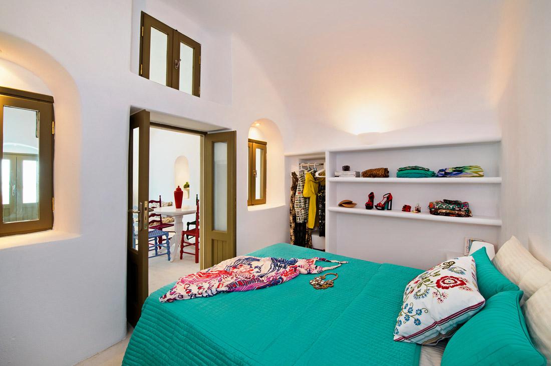 Bedroom with open wardrobe