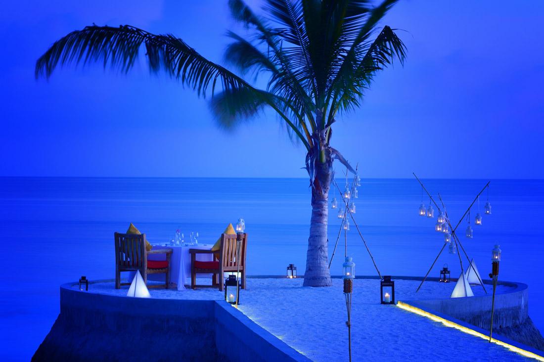 Romantic beach dinner under the stars