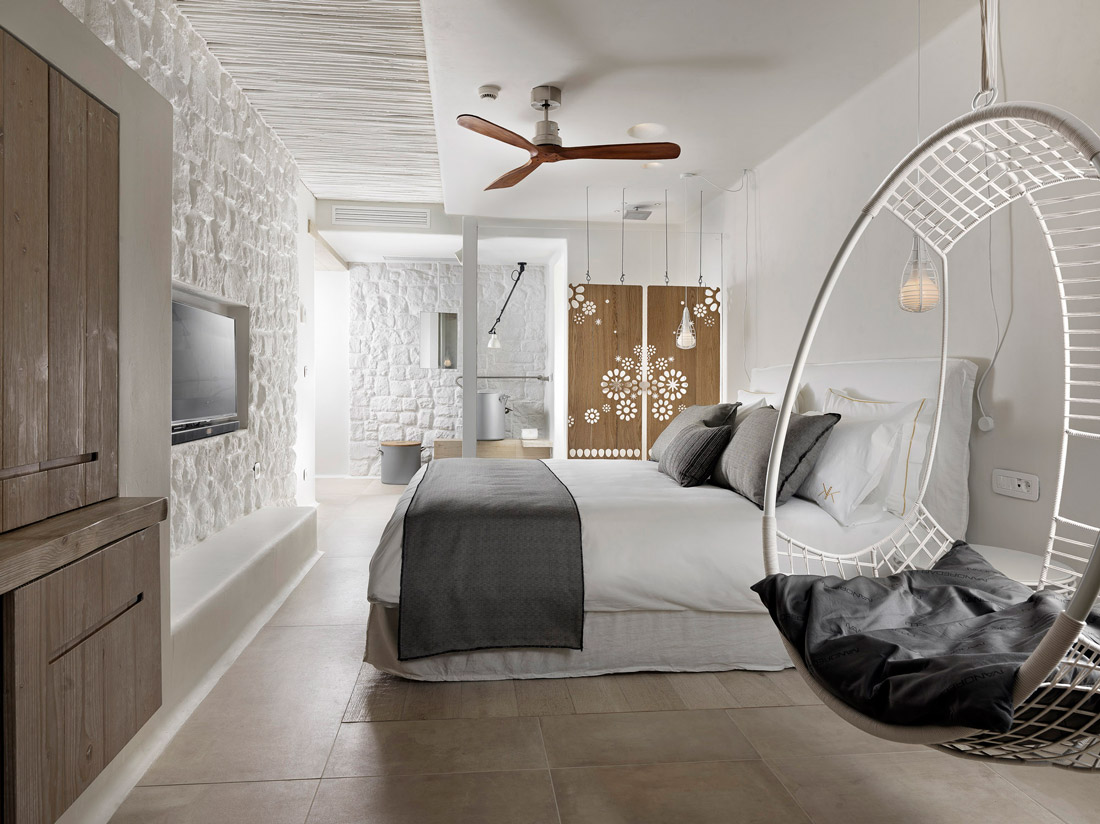 Minimalist bedroom with hanging chair