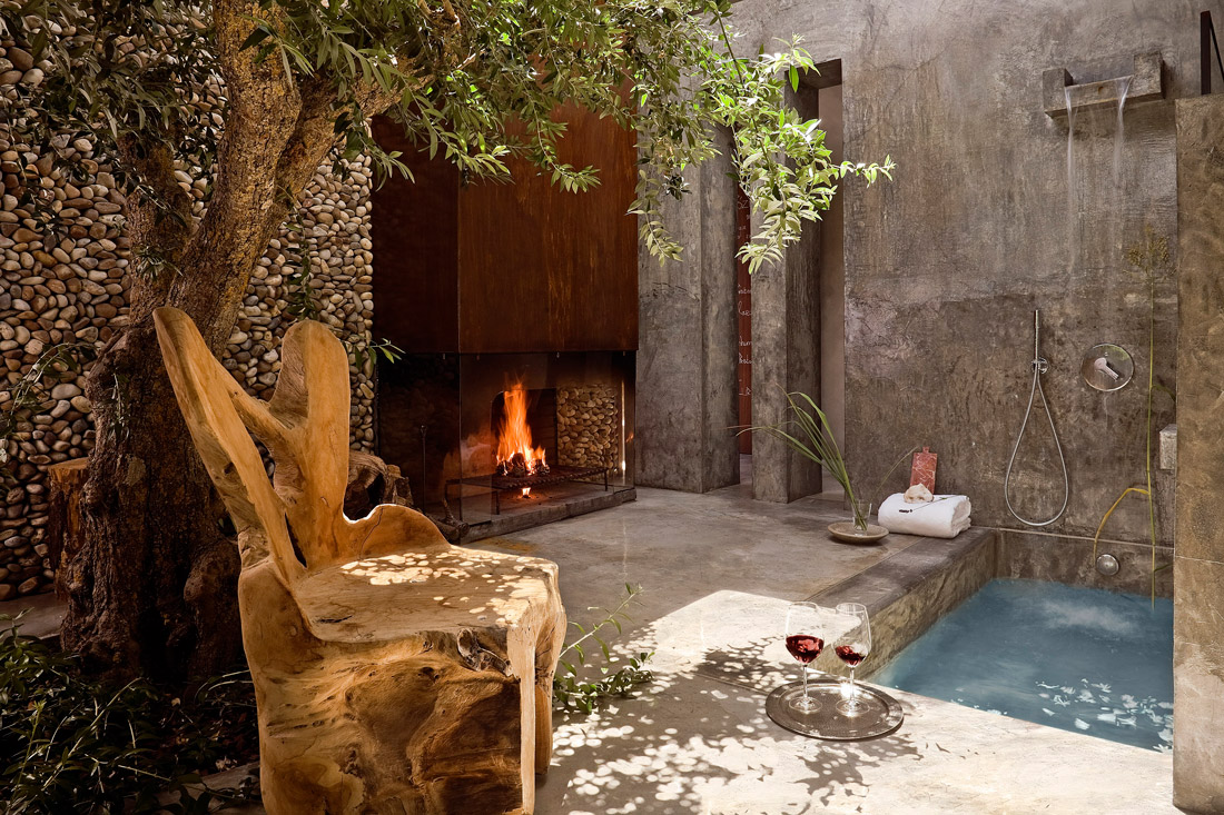 Outdoor space with bath and fireplace
