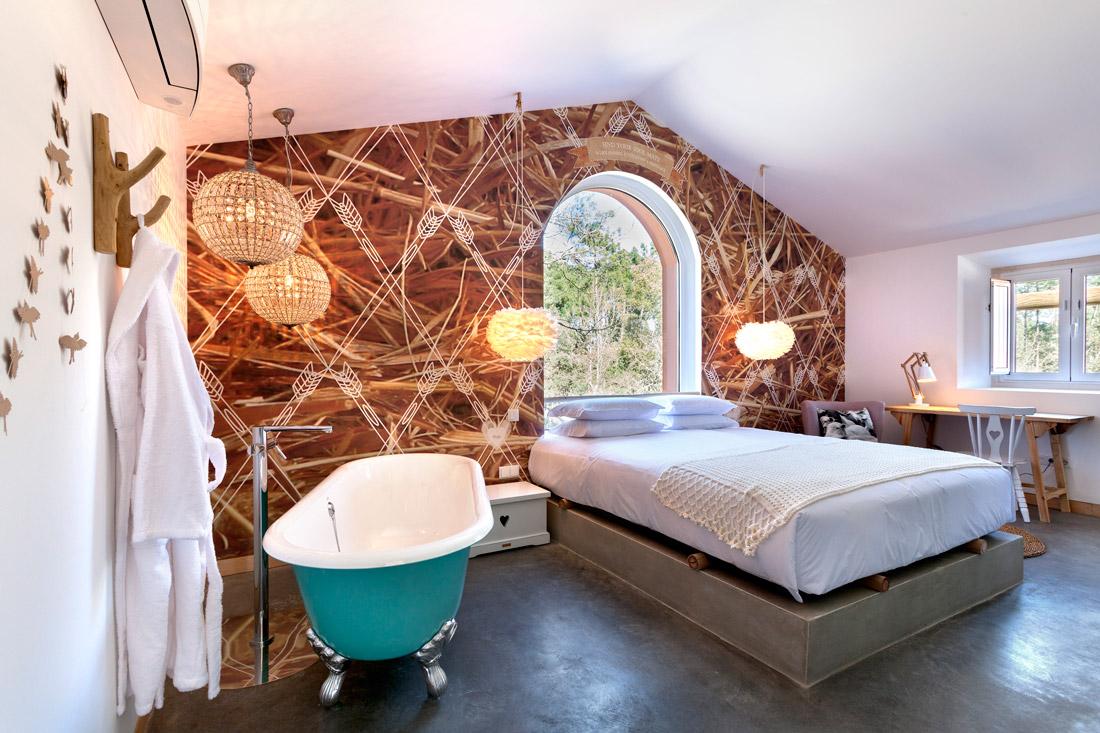 Rustic bedroom with bathtub