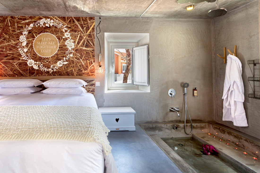 Rustic bedroom with concrete floors