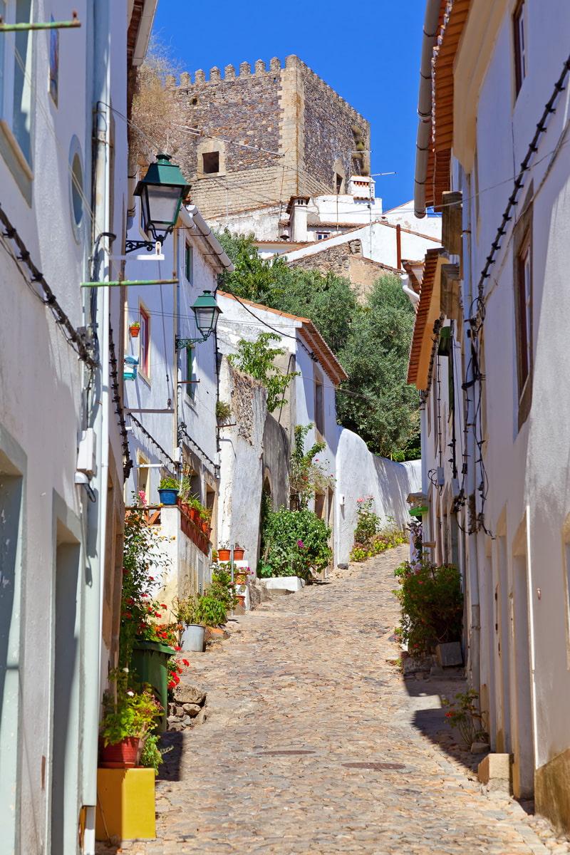 Narrow cobblestone street in Castelo de Vide
